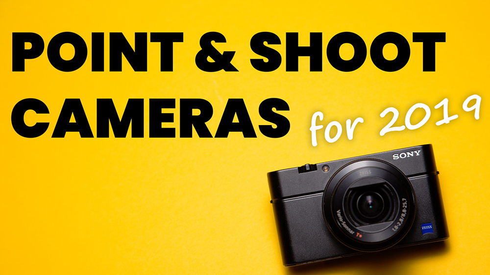 picture of a point and shoot camera laying on a yellow brackground